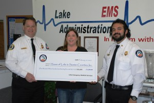 Pictured left to right: Jerry Smith, Lake EMS Executive Director; Rebecca Teston, Assistant Executive Director of Haven of Lake and Sumter Counties; and Lake EMS District Chief Amer Kassas.